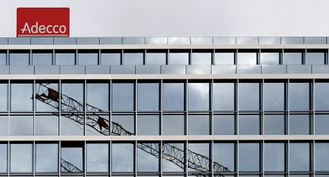 Booming Adecco slashes French jobs