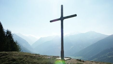 Angry Alpine tour guide chopped down crosses