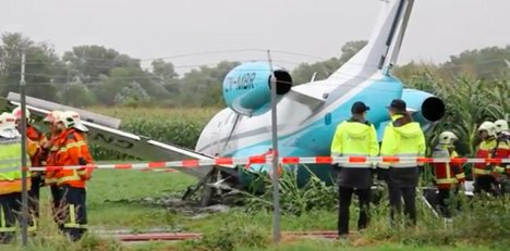 Private jet nearly hits bus after missing runway