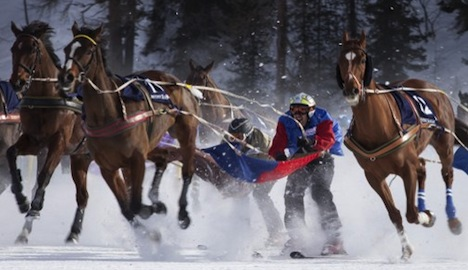 St. Moritz skijoring fans shrug off the cold with champagne and caviar