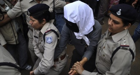 Four charged with Swiss woman's rape in India