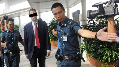 Ex-banker convicted on sex charge in Singapore