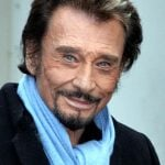 """Johnny Hallyday. The French rock star's official residence is in a chalet at the mountain resort town of Gstaad in the canton of Bern, a renowned playground for wealthy expatriates. According to Le Matin, the star took up residence in 2006 and in 2011 alone earned some €5 million, on which he paid €575,000 in tax - """"or what he spends in two months, according to his entourage.""""Photo: Georges Biard"""