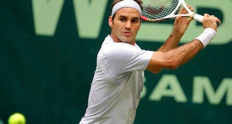Federer clinches first title of season in Germany