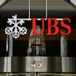 Britain charges UBS trader over Libor scandal