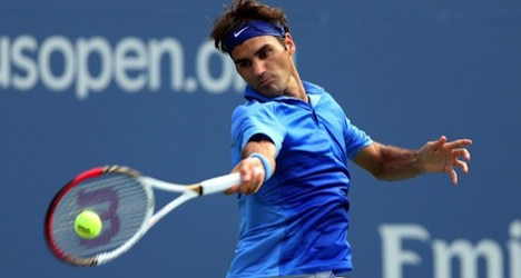 Federer eases into US Open third round