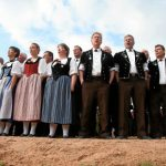 A yodel choir performs in the sawdust ringPhoto: Photo: Monika Flueckiger/swiss-image.ch