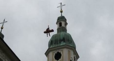 Senior plucked from belfry by helicopter