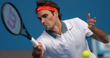 Federer eases into fourth round Down Under