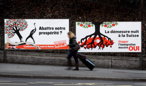 Swiss voters narrowly back immigration curbs