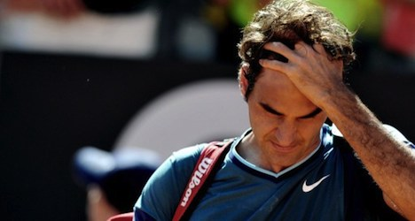 Federer suffers upset loss in windswept Rome