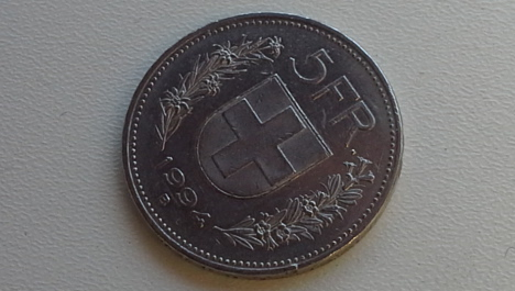 Swiss Post cracks down on fake five-franc coin