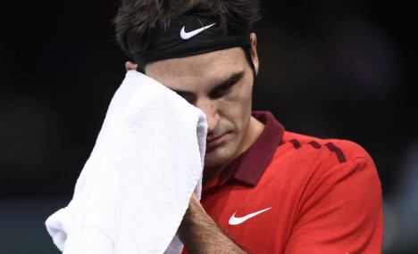 Federer derailed by Raonic at Paris Masters