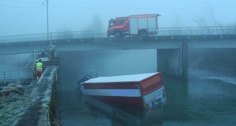 Driver survives truck plunge into Swiss river