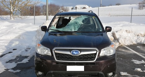 Woman injured as chunk of snow drops on car
