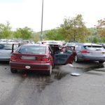 Woman drives into five cars in parking lot