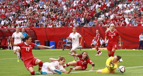Swiss bow out after loss to hosts Canada