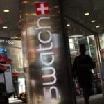 Swatch profit tumbles on strong Swiss franc