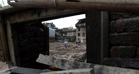 Swiss firm reports dip in global disaster bill