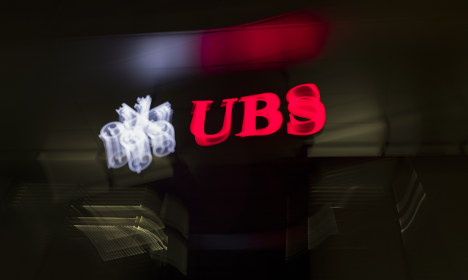 UBS share price tumbles on lower profit result