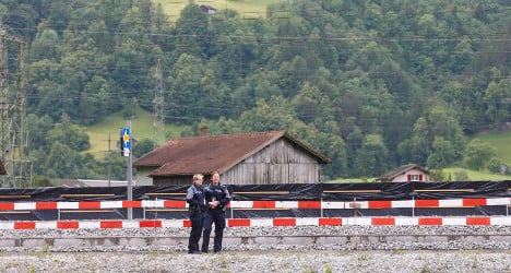 Police search home of Swiss train attacker