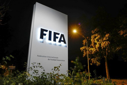 Swiss police search homes in football corruption probe