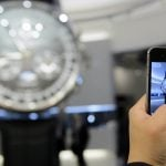 Swiss luxury giant Richemont sees profits halved on watch woes