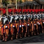 Swiss guards, loyal soldiers of the pope, take the oath