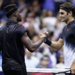 Federer battles through tough test to advance in US Open