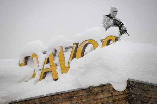 Warnings undermine rosy business forecast in snowy Davos