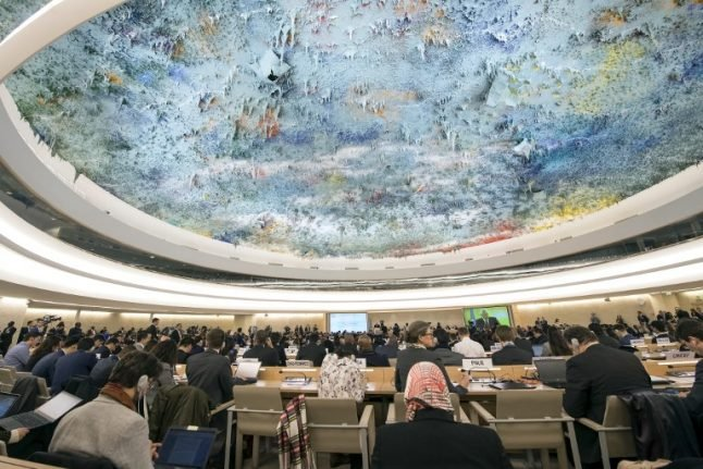 Protests as sanctioned Iran minister addresses UN rights meeting