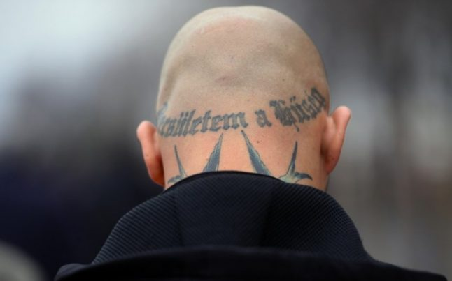 Swiss neo-Nazi who spat on Jew jailed for two years