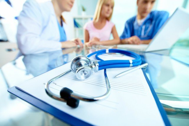 How can health insurance in Switzerland be made cheaper?