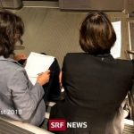 Swiss transport minister snapped sitting on steps of crowded train