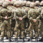 Video: Swiss soldiers ordered to throw stones and nuts at colleague