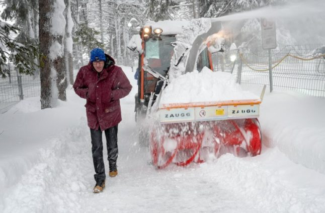 Swiss town's population and hundreds of tourists cut off by heavy snowfall
