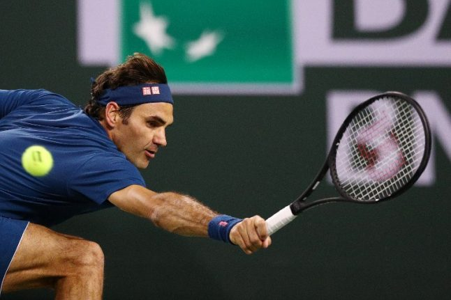 Federer wins 'Swiss battle' to reach fourth round at Indian Wells