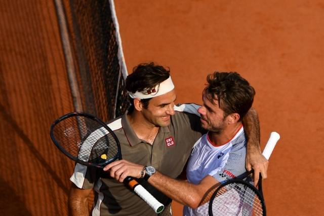 Federer wins Swiss duel to set up semi-final clash with Nadal