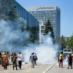 Swiss police fire water cannon, tear gas at Cameroon protesters