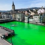 Climate protesters dye Zurich's Limmat River 'toxic green'