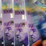 Why do nearly half of Swiss households have debts?