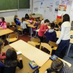 Why are primary school students in Switzerland not required to wear masks?