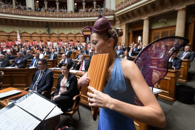 Switzerland rolls back 'antiquated' ban on women showing their shoulders in parliament