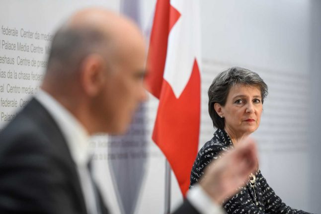 Switzerland promises lockdown measures unless infections subside