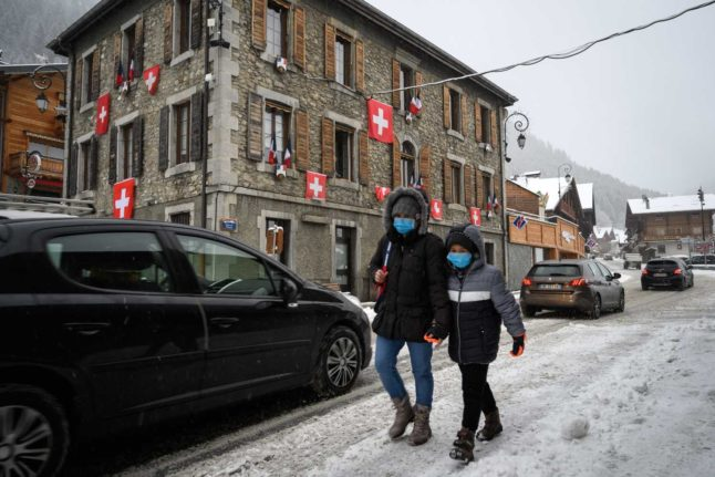 IN PICTURES: Swiss flags hang over protesting French ski village