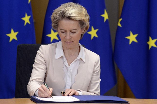 'It's time to put Brexit behind us': EU chiefs sign trade deal with UK