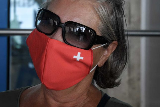 Months after saying masks were not necessary to prevent transmission of the virus, Switzerland relented by putting in place a mask requirement in July of 2020. Switzerland was the last of its neighbours to do so. Photo: Fabrice COFFRINI / AFP