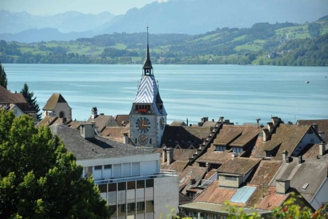 Why are Zug and Schwyz home to the most millionaires in Switzerland?
