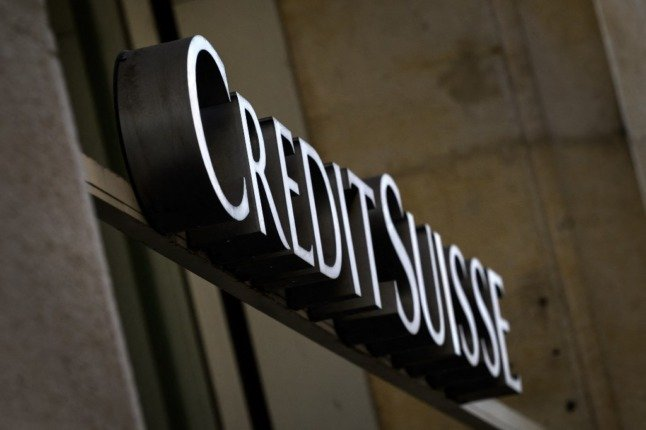 Switzerland's Credit Suisse settles with star banker over spying scandal