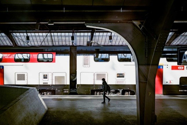 A person walks through the station at Zurich main station